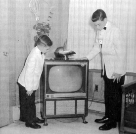 Robert Howard's sons Larry and Richard with a Howard Television set in 1959